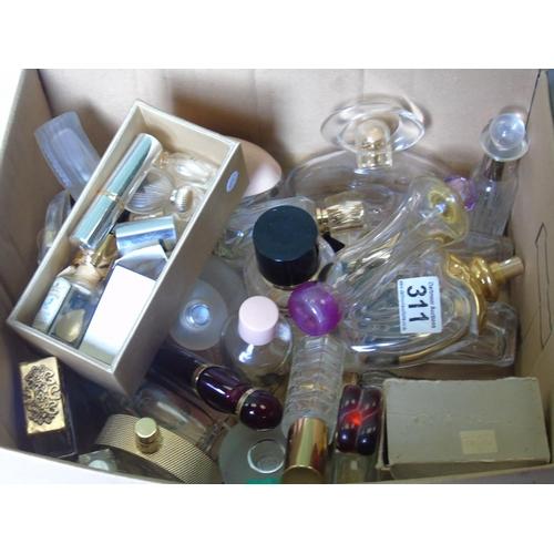 311 - A quantity of vintage perfume bottles...