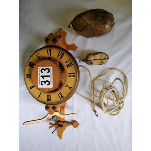 313 - A box containing a wooden clock mechanism, clock face etc...