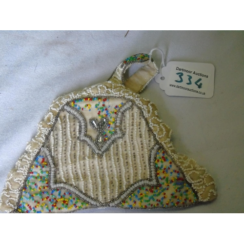 334 - A vintage beaded silk lined purse...