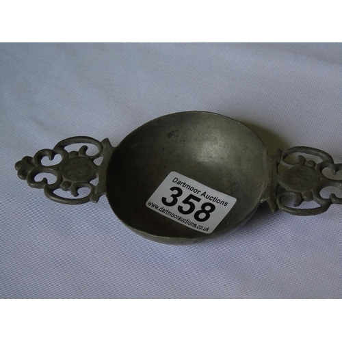 358 - A pewter whisky cup/quaich with two handles...