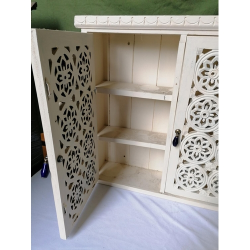 375 - A lot: a painted cupboard with fretwork doors, three shelves, 58 x 58cm; a painted file/letter holde...