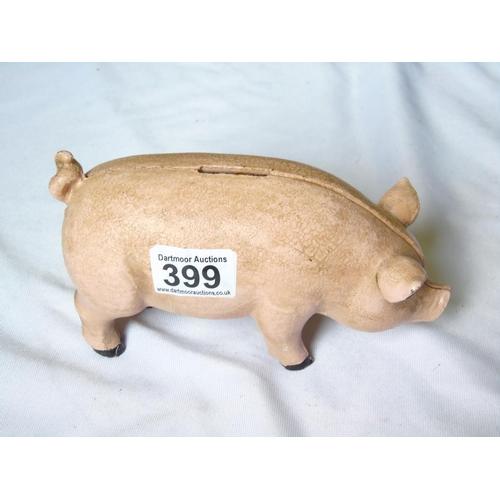 399 - Cast iron pig moneybox...