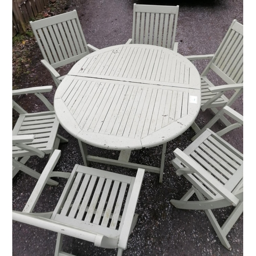 4 - Outdoor garden table and six chairs with seat pads...