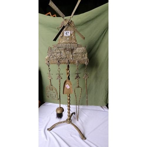 47 - An unusual vintage fireside companion set with windmill scene design...