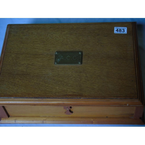 483 - A vintage box with brass plaque inscribed ACC, containing a mallet, a pair of nutcrackers and a scal...