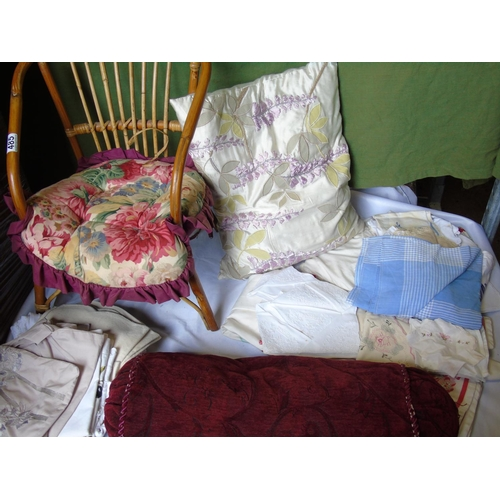 485 - A child's cane chair and assorted soft furnishings...