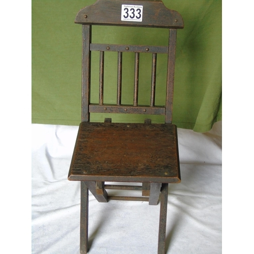 333 - An antique child's wooden folding chair...