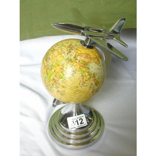 412 - A globe with aeroplane...
