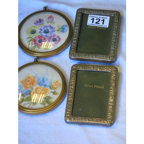 121 - A lot: two small silver plated picture frames; two framed oil on silk floral miniatures...