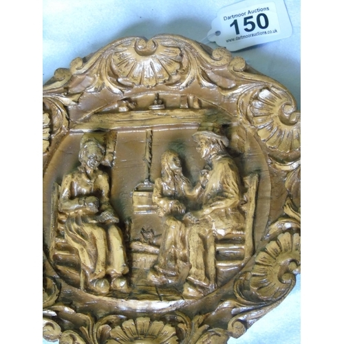 150 - A Pyrenean carved wall plaque with domestic scene...