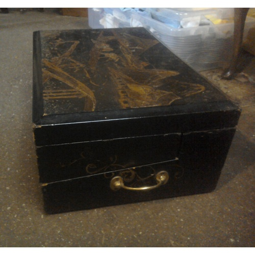195 - A beautifully detailed antique Japanese black and gold lacquer writing box with brass fittings and v...