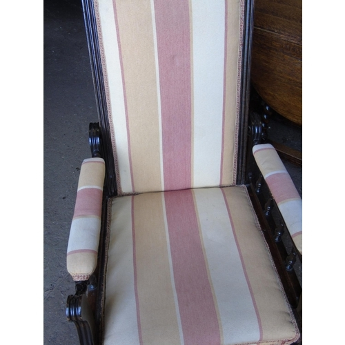 373 - A nursing chair with adjustable back and balustraded arms...
