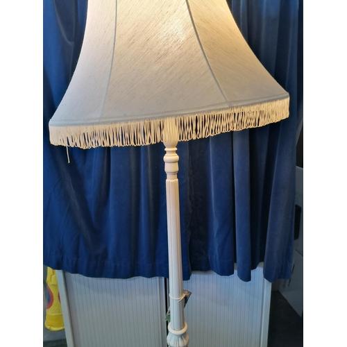 5 - A turned white  standard lamp having, fringed shade