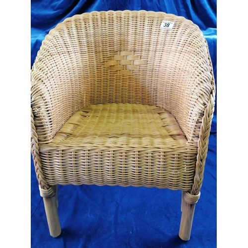 38 - A child's wicker tub chair, ht 50cm...