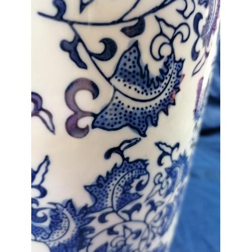 51 - A blue/white china stick stand  decorated with a foliate design...
