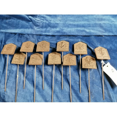 52 - A set of six iron garden herb labels