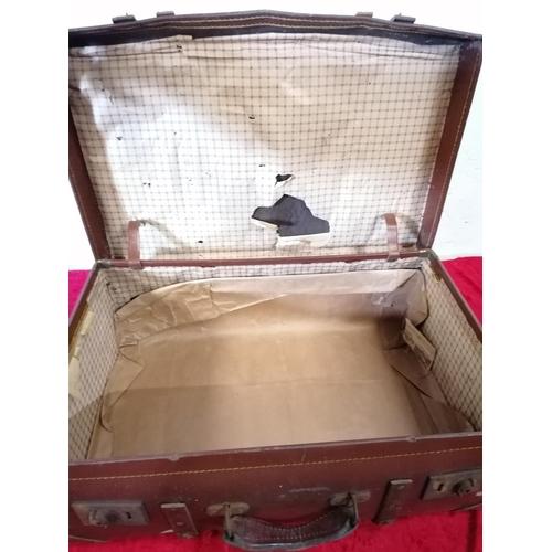 17 - Leather suitcase with impressive interior.