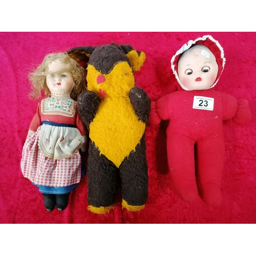 23 - Pair of dolls and teddy