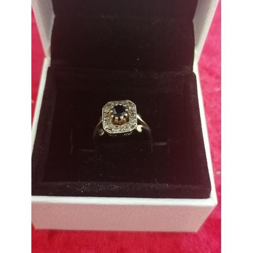 36 - 9ct Art deco shape diamond sapphire ring