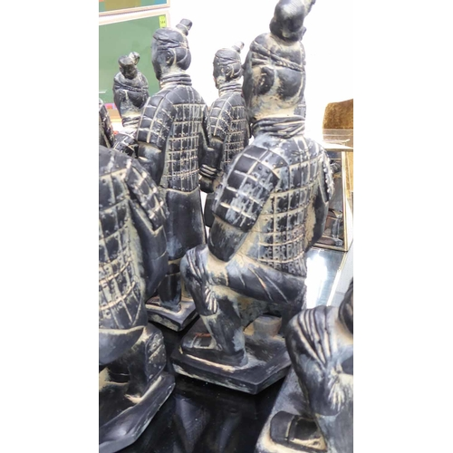 16 - TABLE TOP FAUX TERRACOTTA CHINESE WARRIORS, a set of eight, various poses, largest 35cm. (8)...