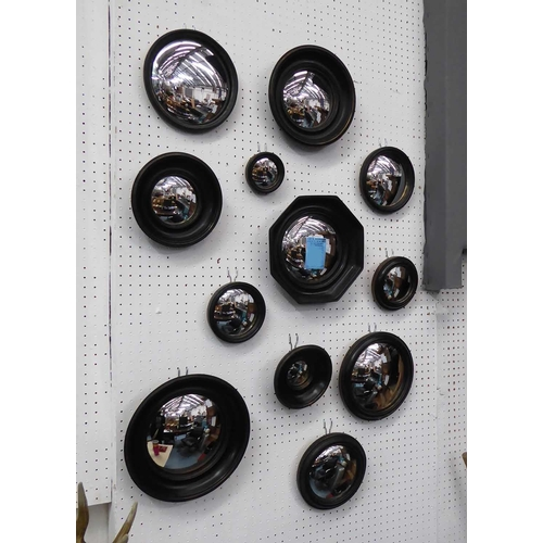 7 - CONVEX WALL MIRRORS, a set of twelve, Regency style, various sizes and shapes, ebonised finish, 26cm...
