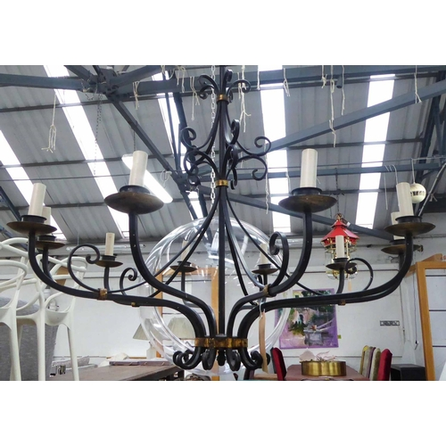 9 - CHANDELIER, ten branch, contemporary worked metal, black painted with gilt accents, 195cm drop x 95c...