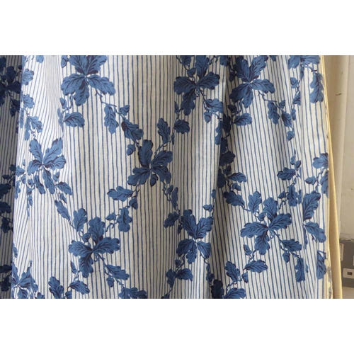 21 - CURTAINS, a pair, lined and interlined in a blue oak leaf lattice design, each 118cm W gathered x 34...