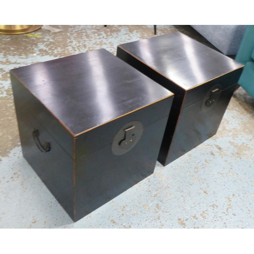 43 - TRUNKS, a pair, Chinese Shanxi style, black lacquered, each with a rising top and a handle to each s...