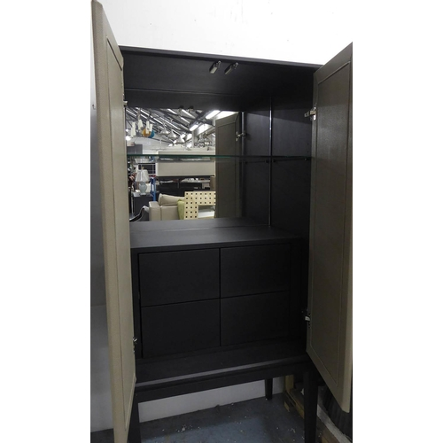 55 - DRINKS CABINET, contemporary design, ebonised supports, 80cm x 50cm x 171cm. (slight faults)...