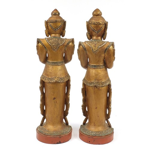 55 - SOUTHEAST ASIAN DEITIES, a pair, carved giltwood. 81cm H (2)....