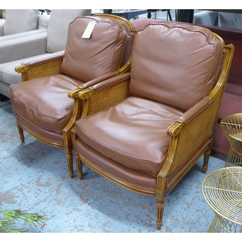 77 - ARMCHAIRS, a pair, contemporary caned frame, leather cushions, 70cm W. (2)