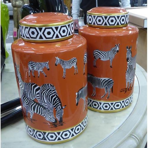 40 - GINGER JARS, a pair, zebra design, 31cm H. (2)