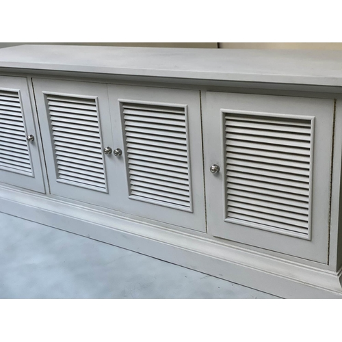 94 - LONG ISLAND STYLE CABINET, sea salt white painted with four louvre doors one enclosing four sliding ...