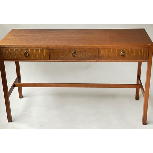 98 - LOUGHBOROUGH WRITING TABLE, 1960's English, teak with three brass inset frieze drawers, 120cm x 46cm...