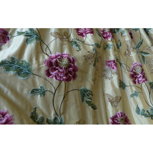 26 - CURTAINS, a pair, lined and interlined, the gold silk field with embroidered floral and butterfly de...