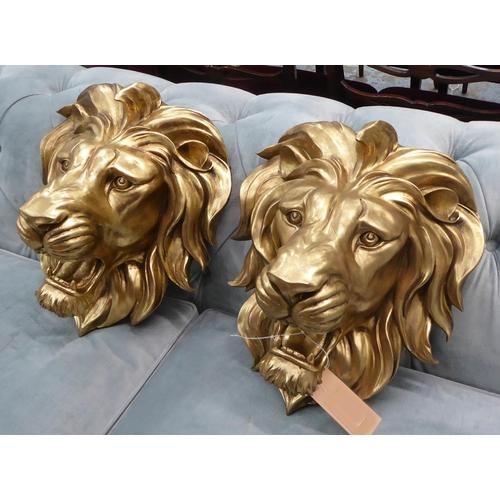 10 - LION HEAD WALL RELIEFS, a pair, gilt finish, 50cm x 40cm. (2)