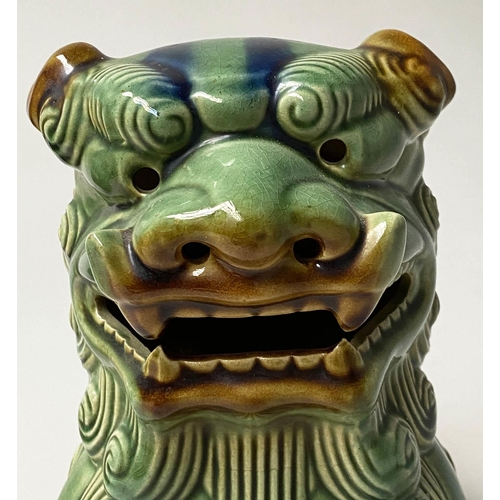 609 - DOGS OF FOO, a pair, Chinese green and brown ceramic, 25cm H. (2)