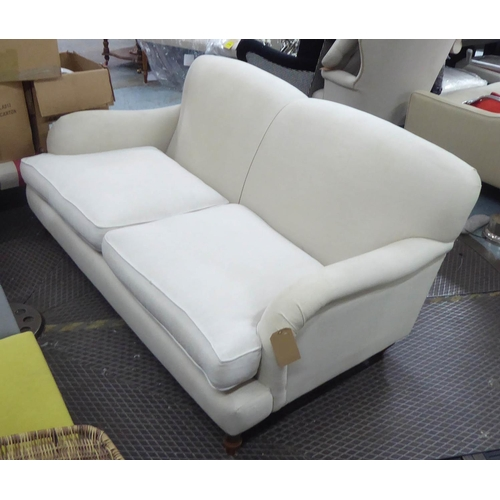 31 - SOFA, Howard style, two seater, with neutral upholstery on short turned front feet, 187cm L x 84cm H...