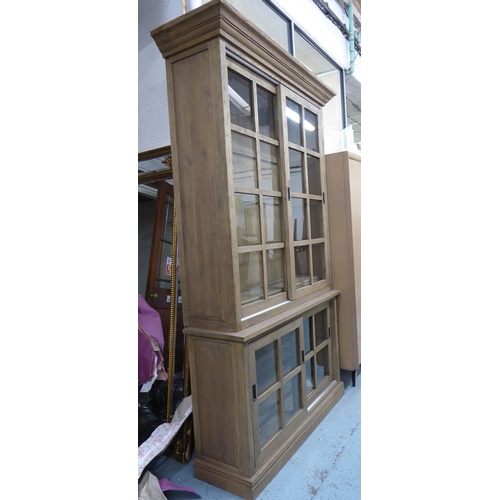 30 - GLAZED BOOKCASE, contemporary design, 126cm x 38cm x 227cm....