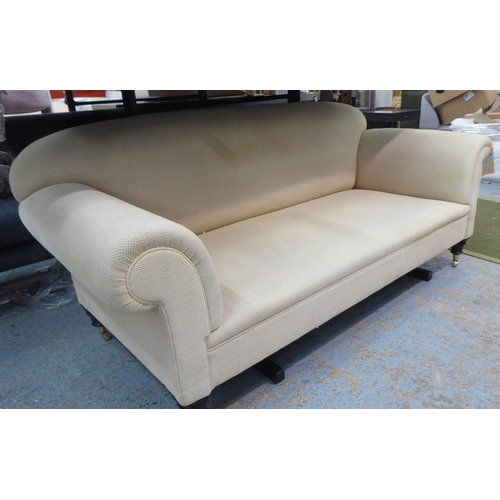 21 - GEORGE SMITH SOFA, with self woven vanilla coloured upholstery on short turned supports with castors...