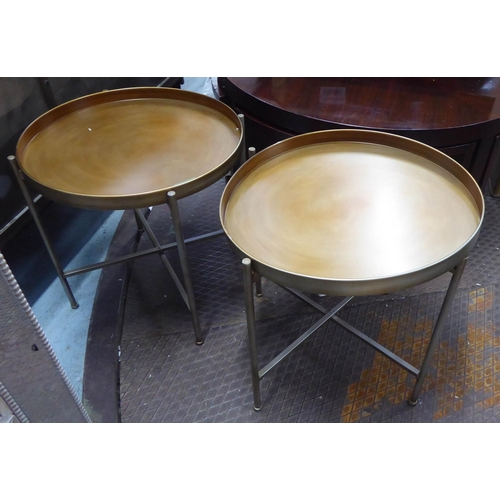 50 - SIDE TABLES, a pair, gilt metal contemporary design, 51cm H x 54cm diam. (2)...