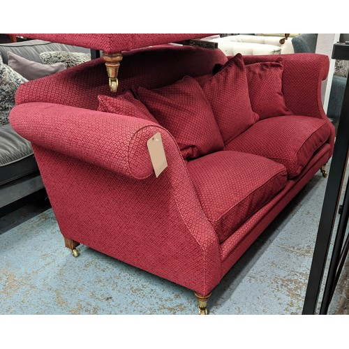 77 - SINCLAIR MELSON LTD. SOFA, with claret upholstery and scatter cushions, (similar to the previous lot...