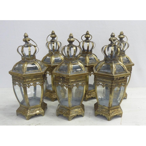 STORM LANTERNS, a set of six, gilt metal and glass, 39cm H. (6)