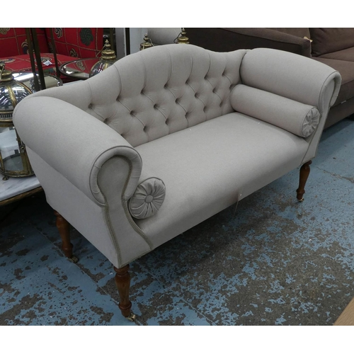 SOFA, Victorian style neutral button back upholstered on turned supports with castors, 130cm W.