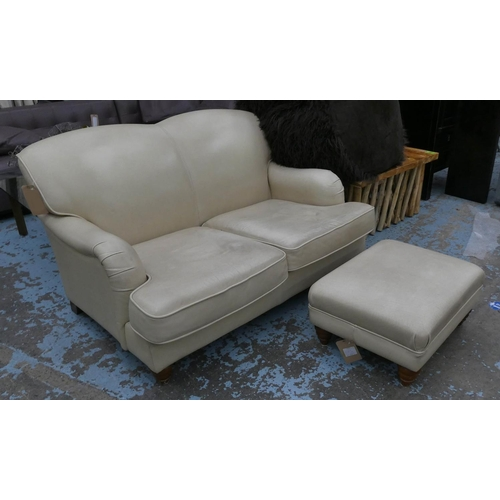 HOWARD STYLE SOFA, leather finish, 140cm W, and footstool. (2)