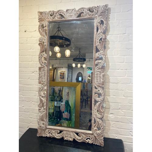 35 - WALL MIRROR, carved lotus flower design limed frame, 150cm x 80cm.