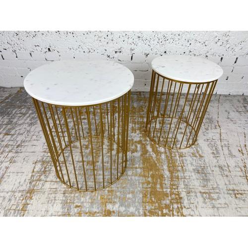 30 - SIDE TABLES, a graduated pair, 1970's Italian design, circular marble tops on a gilt metal base, lar...
