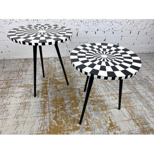 25 - SIDE TABLES, a graduated pair, 1970's Italian design, circular inlaid tops on tripod metal legs, lar...