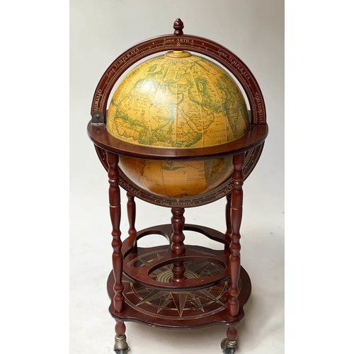 57 - GLOBE COCKTAIL CABINET, in the form of an antique terrestrial globe on stand with rising lid and fit...