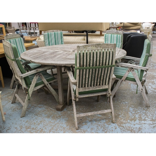 46 - GARDEN SET, including, circular weathered teak table 77cm H x 179cm and a set of six weathered teak ...
